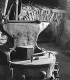 1865 Anvil in Black and White. Anvil, hammer and other tools dating from 1865 depicted in Black and White Stock Photo