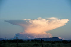Anvil Cloud Thunderstorm in the distance. In west Texas Stock Photo