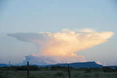 Anvil Cloud Thunderstorm in the distance Royalty Free Stock Photo