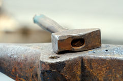 Anvil and hammer. A hammer on an anvil of a blacksmith Stock Photo