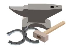 Anvil, hammer and a horseshoe Royalty Free Stock Image