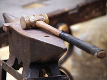 Anvil and hammer Stock Images