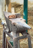 Anvil and hammer. Old anvil with hammer on a metal stump Royalty Free Stock Photography