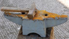 Anvil and hammer. Old and rusty anvil and hammer of a blacksmith Stock Images