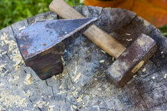 Anvil and hammer. An anvil and a hammer on a tree stump on the street Stock Photography