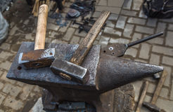 Anvil and hammers. Blacksmith tool Royalty Free Stock Photo