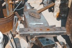 Anvil. on it lies a hammer. blacksmith works. close-up. Forge steel iron industrial metalwork skill craft hot heat handwork workshop equipment traditional royalty free stock image