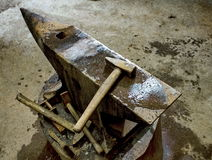 Anvil. Three  hammers and old anvil Royalty Free Stock Image