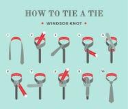 Anweisungen in, wie man eine Bindung auf dem Türkishintergrund der acht Schritte bindet Windsor-Knoten Auch im corel abgehobenen  Lizenzfreie Stockfotos
