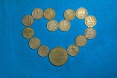 Anwendung der Münzen Lizenzfreie Stockfotos