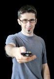 Anwendung des jungen Mannes Fernsteuerungs lizenzfreie stockfotografie