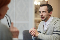 ANxiety. Anxious men telling his story to psychologist royalty free stock photography