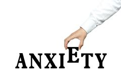 Anxiety. Businessman is holding the text of Anxiety isolated on white background stock photos