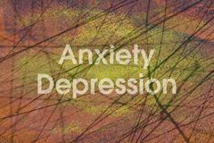 Anxiety and Depression. Words Anxiety and Depression written on a grunge background stock images