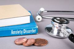 Anxiety Disorder. Blue book on a gray office table. Communication and information royalty free stock image