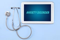 Anxiety disorder text on the digital tablet screen. High angle view of anxiety disorder text on the digital tablet screen with stethoscope on the table stock photos
