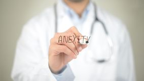 Anxiety, Doctor writing on transparent screen Royalty Free Stock Photos