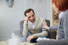 Anxiety. Frustrated men listening to his psychologist advice royalty free stock photo