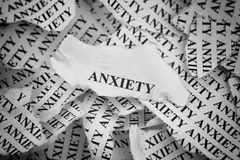 Anxiety. Torn pieces of paper with the word Anxiety. Concept Image. Black and White. Close-up royalty free stock image