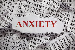 Anxiety. Torn pieces of paper with the word Anxiety. Concept Image. Close-up royalty free stock image