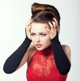 Anxiety. Woman in Emotional Stress and Frustration. Sadness & Discomfort. Upset Woman in Red. Frustration. Sadness Royalty Free Stock Image