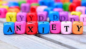 Anxiety word on table. Anxiety word on wooden table Royalty Free Stock Photo