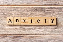ANXIETY word written on wood block. ANXIETY text on table, concept.  Royalty Free Stock Images