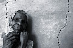 Anxious. An old woman anxiously waiting for her son, who went inside the deep forest of Sunderban to collect honey. Every year the 'Royal Bengal Tiger' of Stock Photography