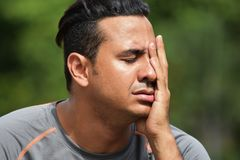 Anxious Adult Male Athlete. A handsome adult hispanic man Stock Images