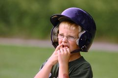 Anxious Base Runner. Young boy in glasses is an anxious little league baseball runner Royalty Free Stock Images