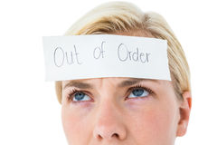 Anxious blonde woman with sign on her forehead Royalty Free Stock Images
