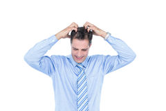 Anxious businessman with hands on his head Stock Photo
