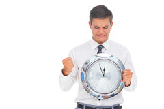 Anxious Businessman Holding And Looking At Clock Royalty Free Stock Photography