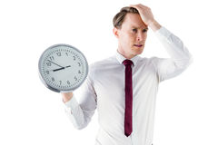Anxious businessman holding a clock Stock Photos