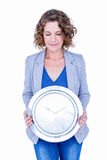 An anxious businesswoman holding clock Royalty Free Stock Images