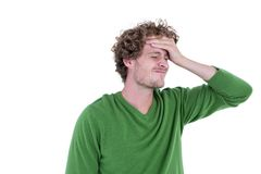 Anxious casual man standing with hand on forehead Stock Photography