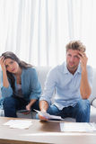 Anxious couple doing their accounts Stock Images
