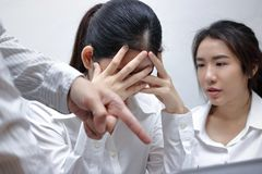 Anxious depressed young Asian business women are being blamed with boss in workplace. Royalty Free Stock Photography