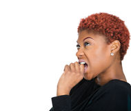 Anxious female biting nails looking with craving Royalty Free Stock Photo