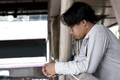 Anxious and frustrated Asian business man in depression looking at far away.  royalty free stock photo