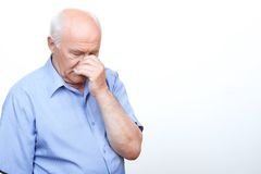 Anxious grandfather touching his head Royalty Free Stock Photos
