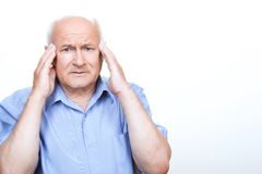 Anxious grandfather touching his head Royalty Free Stock Photo