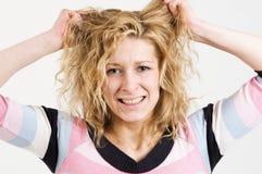 anxious hair pulling woman Fotografering för Bildbyråer