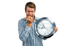 Anxious late man holding a clock. On white background Stock Photography