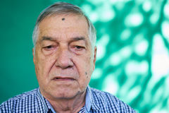 Anxious Latino Senior Man With Sad Worried Face Expression. Real Cuban people and emotions, portrait of sad mature latino man from Havana, Cuba looking at camera royalty free stock image