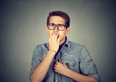 Anxious man biting fingernails nervously Royalty Free Stock Photography