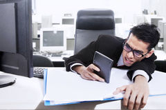 Anxious man calculating fear of bankruptcy Stock Images