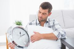 Anxious man beside a clock Stock Photography