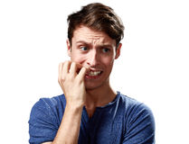 Anxious man face. Anxious nervous young man face expression. People emotions portrait Royalty Free Stock Photography