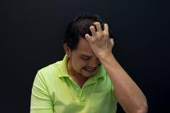 Anxious man feeling sadness. Anxious asian short hair man feeling sadness and stress Stock Image